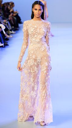 """ELIE SAAB """"We have spotted Kim wearing countless fitted long-sleeve silhouettes in the past months, and they happen to be incredibly flattering on her. This Elie Saab spring couture collection would be an ultra feminine and demure choice,"""" Avidan-Cohn, says."""