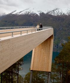 """Aurland Lookout (Norway). """"The """"truncated bridge into mid-air"""" thrills visitors with a breathtaking view of one of the west coast's largest fjords. Specifically commissioned to showcase Norway to visiting tourists, the Aurland Lookout—opened to the public in 2006—has quickly become one of the country's iconic (and most-lauded) structures...The edge-of-the-earth sensation is heightened by the clear-glass barrier at the overlook's edge..."""""""