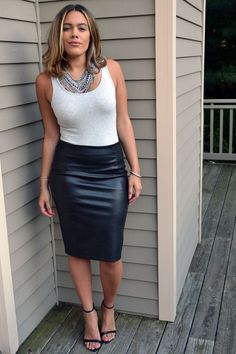 Sexy girl in leather skirt outfit
