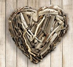 """Our natural driftwood heart is handcrafted with unique pieces in various sizes, harvested from the California coast. Sawtooth hanging hardware included for easy hanging. Approximately 16"""" x 16"""". Because of the natural materials used, each driftwood heart is unique"""