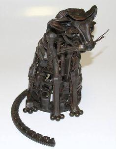Барри Кроуфорд - механический Кот в стиле стимпанк Тенденции. Я построил этот натуральную величину скульптура кота из автозапчастей и другой мусор. Узнайте больше моей работы в моей деловой странице Facebook Кроуфорд металлургический завод, или на моем сайте www.crawfordmetalworks.com http://emporioefikz.tumblr.com/