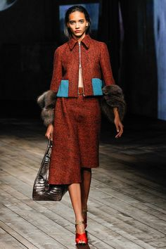 Prada Fall/Winter 2013 Ready-to-Wear Collection via Designer Miuccia Prada; modeled by Beauty Cora Emmanuel