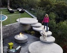 so cool for a back yard, oversized disks of concrete seem to float between levels