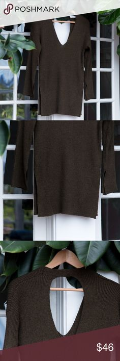 Lush olive green open back sweater Beautiful knit long sweater. Has open side slits at the hips and matching ones on the sleeves. Big open keyhole on the back to show off your lacey underthings. Barely worn, great condition other than tiny loose thread (see last pic). 70% Polyester and 30% nylon. Lush Sweaters V-Necks