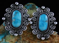 Two matching high grade natural Blue Gem turquoise cabochons were selected to create these lovely earrings by Navajo artist Terry Martinez. The gems are sky blue with delicate water web matrix. They are set in hand made bezels surrounded in twist wire. Rare Gems, Silver Work, Turquoise Stone, Blue Gem, Gemstone Rings, Swirls, Navajo, Balls, Gemstones