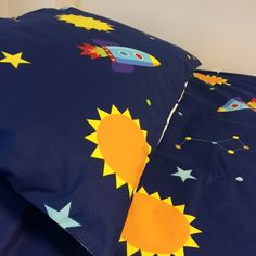 Go on an adventure to outer space with this bright and vibrant reversible space cot bed duvet cover set. Made from cotton, this children's duvet cover set is both durable and comfortable, and is the perfect solution to a peaceful night's sleep. Cot Bed Duvet Cover, Cot Duvet, Duvet Cover Sets, Childrens Duvet Covers, Mattress Protector, Bedroom Accessories, Kid Spaces, Comforter Sets, Luxury Bedding