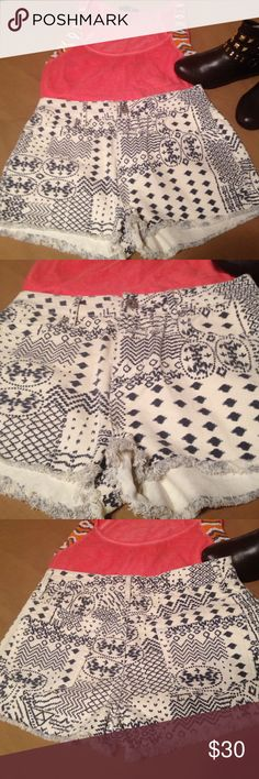 Bullhead High Waisted Navy/Wht Denim Shorts Navy and white cut off denim shorts. Tribal print, by bullhead denim company. High-rise, short size 9. No flaws in brand-new condition without tags Bullhead Shorts Jean Shorts