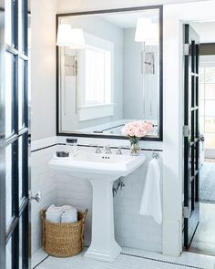 Traditional Bathroom with hand crafted subway tile, Memoirs Pedestal Sink, wicker basket, faux horn canisters LarsonJuhl Mirror frame and pink roses. White Bathroom, Bathroom Interior, Bathroom Mirrors, Master Bathroom, Contemporary Bathrooms, Modern Bathroom, Lava, Beveled Subway Tile, Subway Tiles