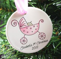 Baby's First Christmas Personalized Ornament Baby Girl Pink  Carriage Personalized Ornament. $19.00, via Etsy.