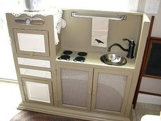 My version of the homemade play kitchen.  Top of hutch, turned upside down.
