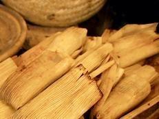 Buffalo Tamales recipe from Robert Irvine via Food Network Tamale Sauce, Tamale Recipe, Beef Tamales, Robert Irvine, Tyler Florence, The Husk, Red Chili Powder, Shredded Beef, Food Network Recipes