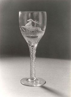 Wine glass engraved with a leaping stag. Engraved by William Garnet Webb at Stuart Crystal, Stourbridge.