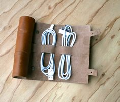 This Cordito (cord wrap) holds 3 cables & 2 plugs. A gorgeously simple way to wrap your USB cords, earbuds, plugs and go. Made from premium leather and precisely measured to neatly hold your cords, earbuds, plugs and go. Cord Organization, Cord Storage, Organizing Tips, Craft Storage, Leather Cord, Leather Pouch, Tan Leather, Leather Keychain, Getting Organized