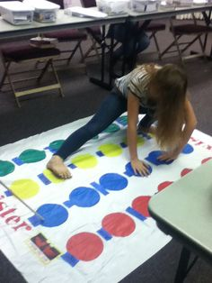 Scripture mastery twister! This works for short verses . You need a spotter and a player. The spotter finds the words in order and gives the player directions as to what hand or foot goes on that spot. I used painters tape to write the words on the mat. Verses can only be 24 words long. We played this for D&C 19:23