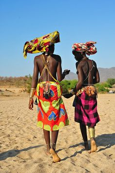 Africa |  Mukubal woman chatting on a dry river bed, South West Angola |  © Luca Gargano, via Flickr