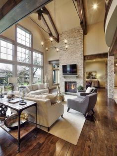 Rustic Living Room with Crate and barrel driftwood coffee table, tv wall mount, Columns, Cathedral ceiling, stone fireplace Transitional Living Rooms, Transitional Decor, Modern Living, Style At Home, Home Design, Living Room Furniture, Living Room Decor, Living Area, Driftwood Coffee Table