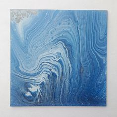 Original fluid acrylic painting on gesso board. This piece is inspired by a blue lace agate geode and the silver just adds a touch of magic and shimmer to this piece! Its perfect for standing on a small tabletop easel on and end table or a desk. Title: Blue Agate Size: 6x6 and