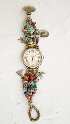 Watch made by Karen Stefanoff made with African trade beads, silver charms, and turquoise