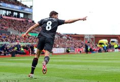 Gerrard celebrates his final strike for Liverpool before he leaves the club and joins LA Galaxy in the MLS in July