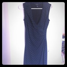 """Black and blue wrap dress. """"Wrap"""" dress. It looks like a wrap but is not. Great material, bought it to wear to the office. Comes to my shins Express Dresses"""