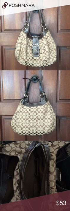 Coach Signature Soho Lynn Hobo Bag, Brown/Khaki Gently used authentic Coach hobo; brown and khaki in color with the signature Cs. I love this purse but I just never use it anymore. It's in nice condition; a couple smudges on the bottom (see photos) and a tiny mark on the back that I'm not even sure I could get a picture of. Bag has three openings and then a zippered pocket in one of them. Lots of room! No tears and the corners are all in good shape. Hate to part with it but it's doing no…