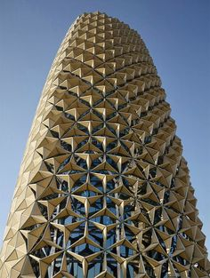 Al Bahar Towers : Aedas Ltd. Each module on the facade responds to the level of sunlight, opening and closing: