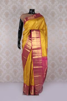 Golden yellow pure kanjeevaram silk comely saree with pink & gold border