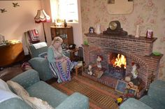 1940s sitting room Lady making a rag rug at the Old Forge Wartime House Sittingbourne Kent