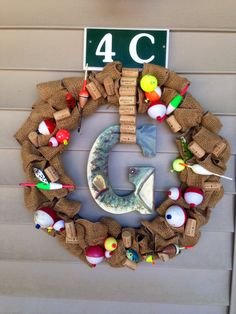 Added some additional corks...THAT'S the easy part. Wine corks and fishing lures...says it all!