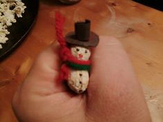 make a snowman - out of a peanut shell