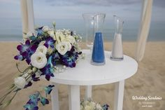 Blue orchids and white lisianthus table decoration.