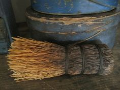 old whisk broom and wooden containers