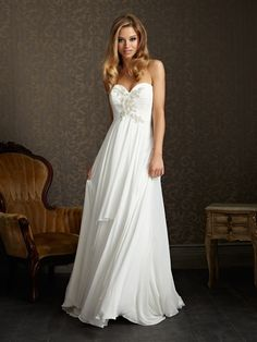 Style: 2504    Perfect for a destination wedding. This lovely chiffon gown has a strapless, sweetheart neckline, ruched empire bodice and sparkling crystal detail.