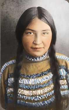 A Siksika girl. Early 1900s. Glass lantern slide by Walter McClintock.