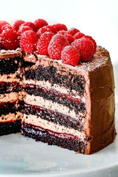 Chocolate Raspberry Cake with sliced removed showing layers of dark chocolate cake, raspberry jam filling, chocolate ganache and chocolate mousse Chocolate Raspberry Cake, Dark Chocolate Cakes, Chocolate Desserts, Chocolate Ganache, Raspberry Cake Filling, Rasberry Cake, Chocolate Cake With Strawberry Filling Recipe, Chocolate Cake Fillings, Chocolate Cake With Strawberries