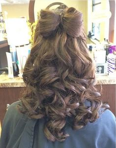 half up bow updo with curls