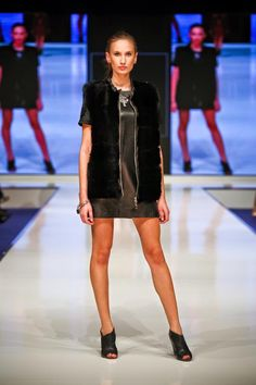 Leather black dress & fur vest. Woman's Fashion / Fashion Show