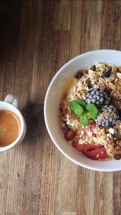 Fruitbowl breakfast with espresso, frozen berries