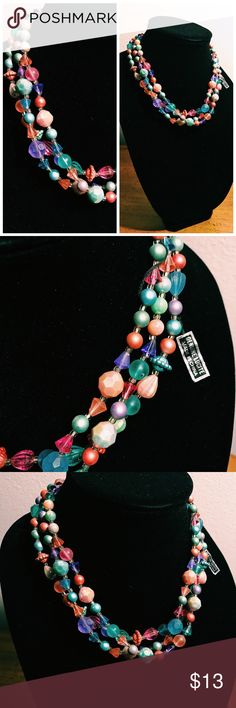 """Vintage 60s Lucite Three Strand Beaded Necklace Beautiful #60s , possibly #50s , three strand beaded necklace. The colors are so pretty! Coral, pink, purple, and teal. Still has original tag marked """"Genuine Lucite Made in China"""". #vintage #vintagejewelry #vintagejewelryforsale #multistrandnecklace #beadednecklace #coral #pink #pastels #springjewelry #easter #easterjewelry Vintage Jewelry Necklaces"""