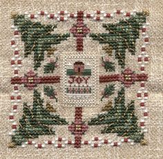 A Little Joy, from the 2002 Just Cross Stitch Christmas ornie magazine. You can also replace the over one stitched JOY with a tiny frame sold by Just Nan.: