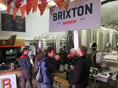 Bottling plant and Brewery vessels at the rear of the railway arch. Rough concrete floor. Brixton brewery.