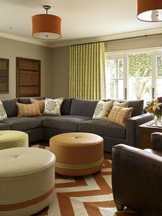 orange and gray, chevron rug, gray couch, orange drum shades