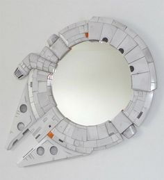 This Millennium Falcon mirror would look mighty fine on my wall. Just sayin.