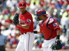CrowdCam Hot Shot: Texas Rangers starting pitcher Yu Darvish and catcher Geovany Soto meet on the mound for a conference against the Oakland Athletics during the second inning of a baseball game at Rangers Ballpark in Arlington. Photo by Jim Cowsert