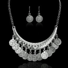 Coin Jewelry Set Pretty antique silver toned coin necklace with clear stones. Has matching earrings. New in package. So pretty! The gold necklace set is not for sale. It is just showing size. Jewelry Necklaces