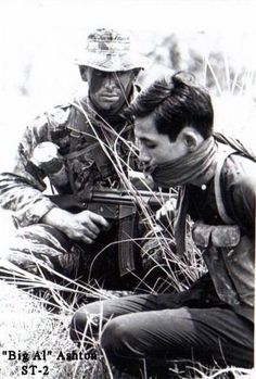 Navy SEAL with VietCong prisoner. Note the G3 rifle with 30rd. magazine