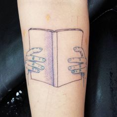 Here's little hands and book on top of Terra's blackberry bush scratches. #tattoo  #shannonperry #valentinestattooseattle