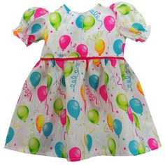 This is a great little party dress with colourful balloons and streamers and a glittering of silver.  See the close-up shot of the fabric to see how gorgeous this fabric really is!  A bright pink trim around the waist completes the outfit.  Dress fastens at the back with a Velcro strip.