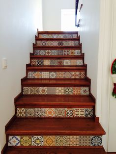 Oak stairs with ceramic tiles raisers.