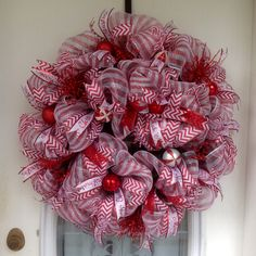 "30"" Red/White Striped Deco Mesh on Evergreen Christmas Wreath with Candy Canes and Red And White Ribbons and Ornaments"